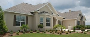 one story florida home with manicured landscaping home insurance rates in florida