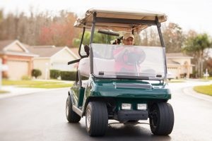 Senior Man Driving Golf Car in the Villages, FL
