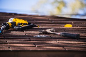 loose tools on home roof what to know when hiring a contractor