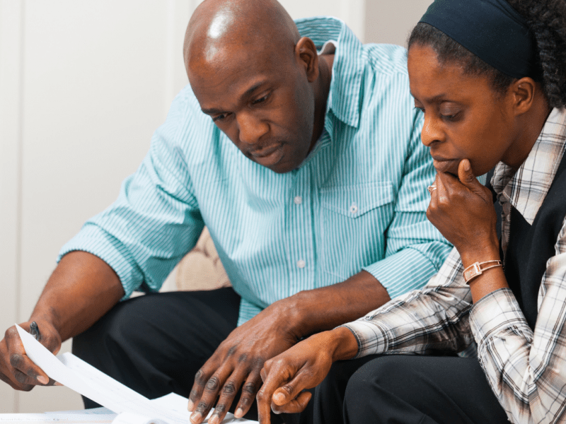 Man and woman reviewing documents
