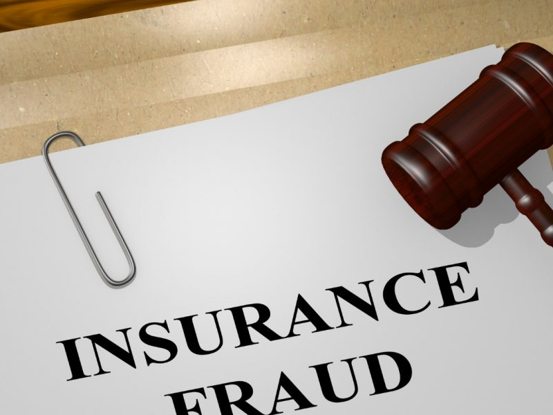 Insurance Fraud written on paper with gavel